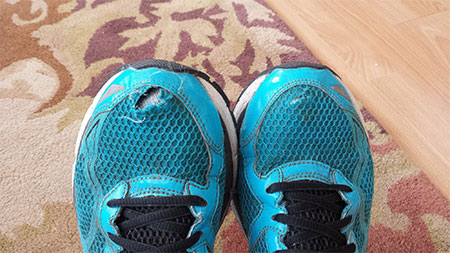 running shoes blown-out toe