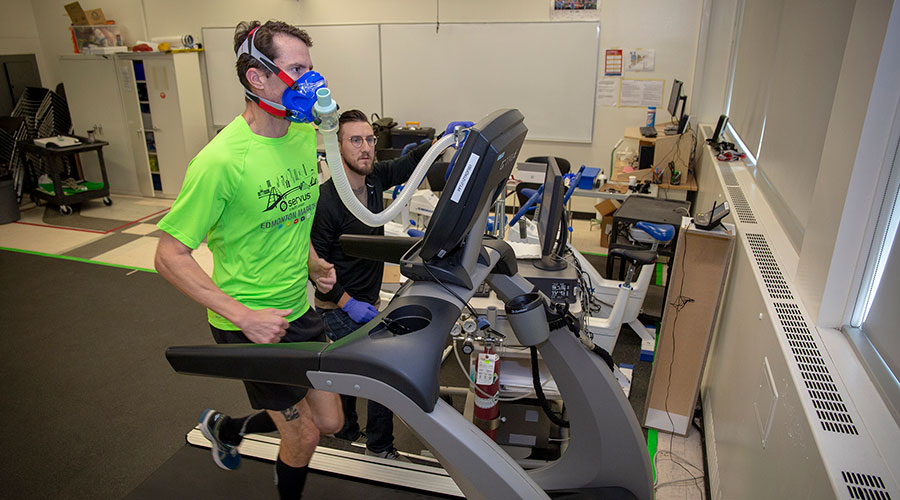 nait personal fitness trainer instructor Dr. Tim Just administers a VO2 max test for runner Scott Messenger