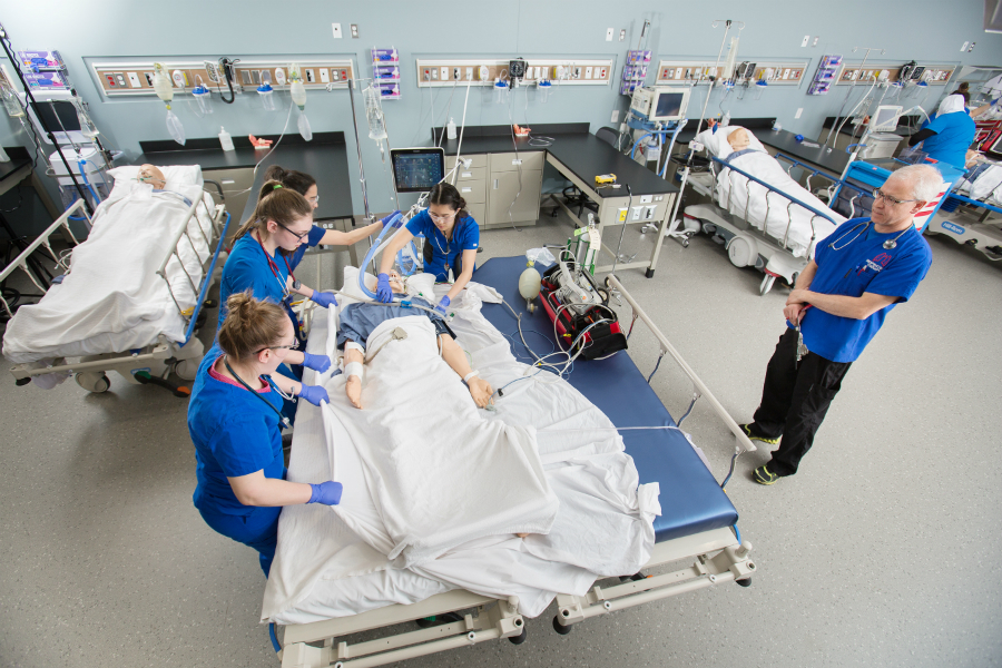 NAIT respiratory therapy students practice on a high fidelity mannequin