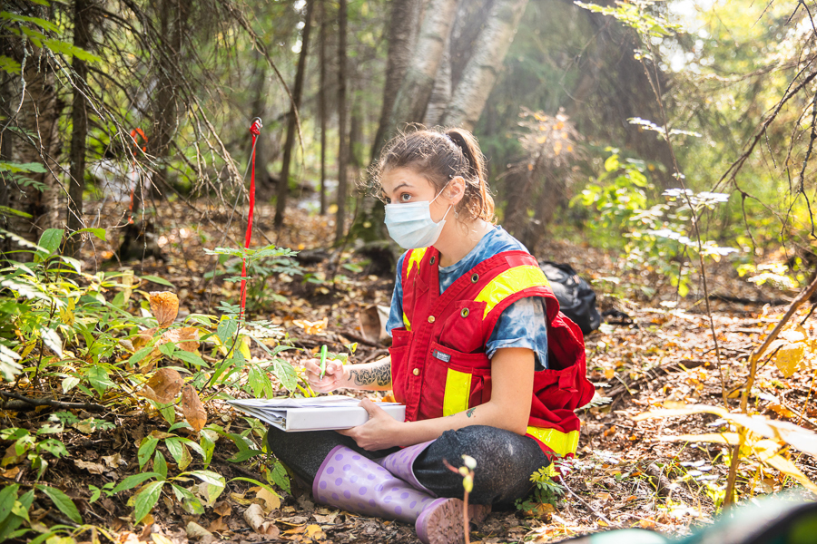 Female student conducts field work