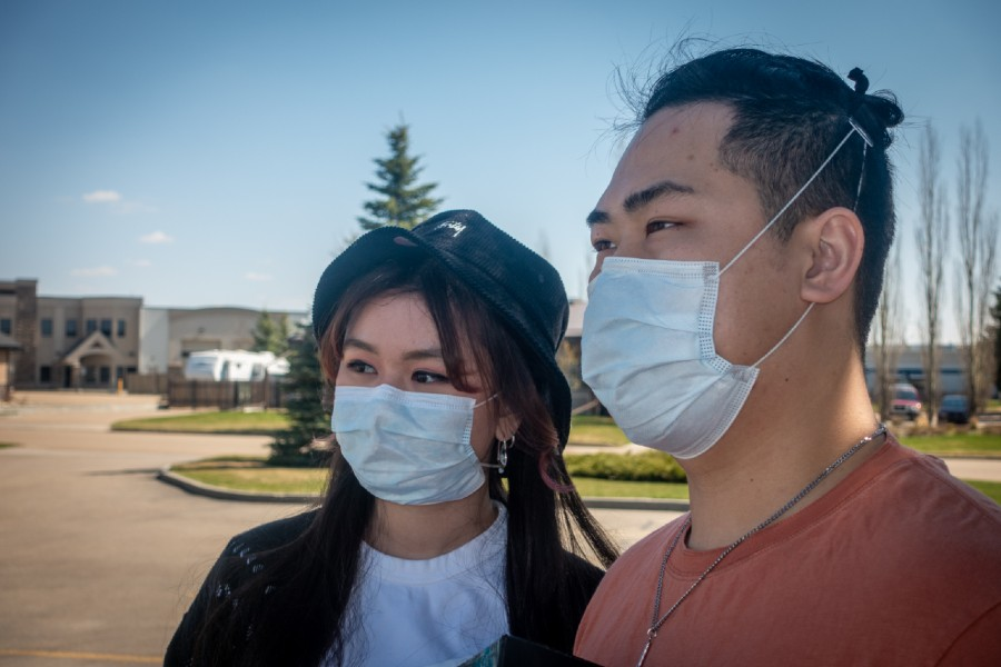Jonathan Mui and Denise Bermejo, NAIT DMIT grads and makers of ear protectors for COVID-19 frontline workers