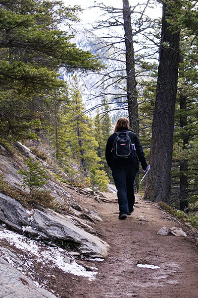 hiker on banff's commonwealth walkway
