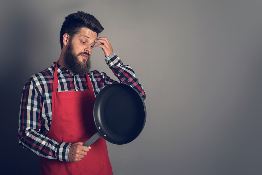 dude staring at frying pan before cooking