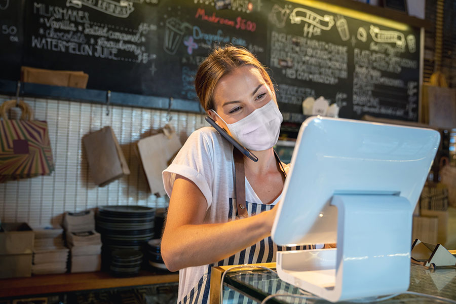 happy waitress wearing a mask