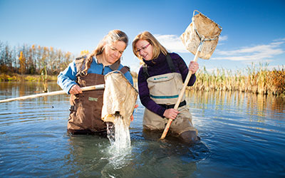 laurie hunt and debbie webb in the sturgeon river